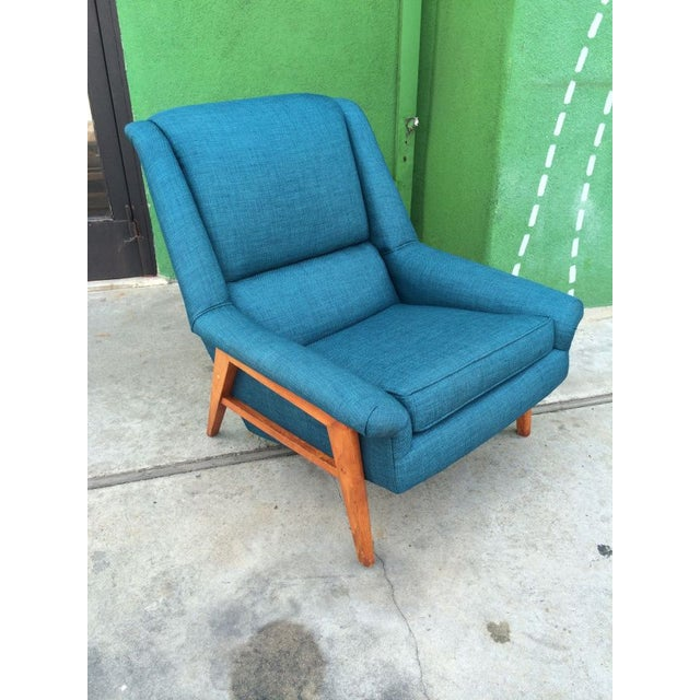 A cool Mid-Century Modern teak lounge chair in a standout color. In excellent restored condition with new turquoise tweed...