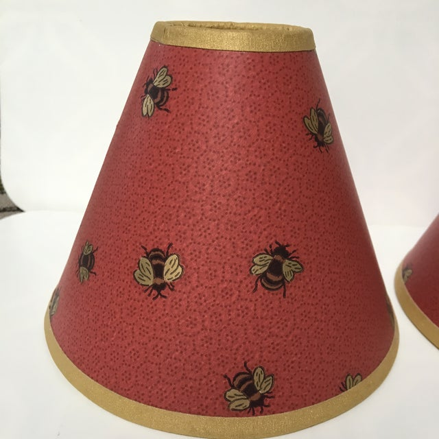 This is a pair of beautiful dark red shades from the 1990s. These shades feature gold and black bees on a background that...