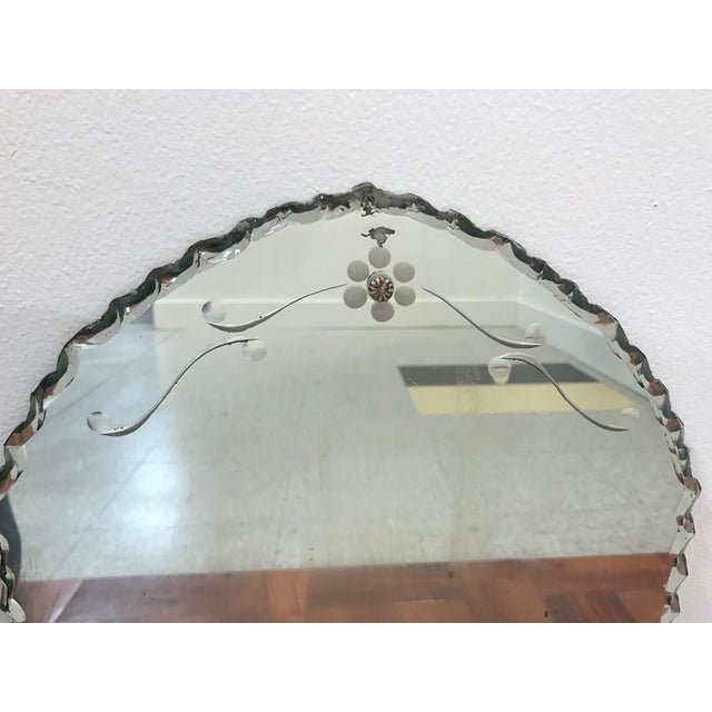 Beautiful frameless mirror with pie crust edges and etched floral design. Lovely leaning in a vignette, as part of a...