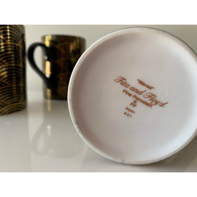 """Elegant deco style porcelain """"wave"""" mugs in black and gold, crafted in Japan. Width: 3"""" w/o handle Height: 4"""""""