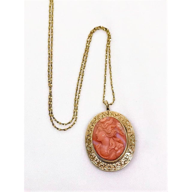 Ornate antique 14k gold oval brooch/pendant bezel set with a hand carved, high relief coral cameo. This fine early 1900s...