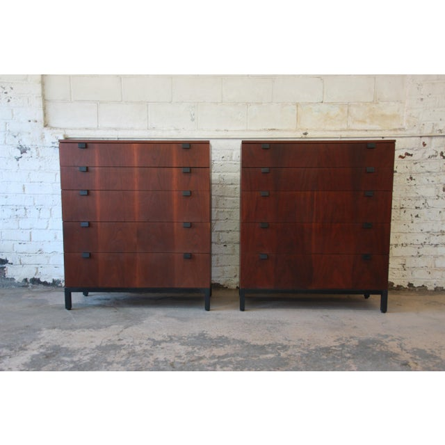 Offering a rare and outstanding pair of Mid-Century Modern rosewood highboy dressers designed by Milo Baughman for...