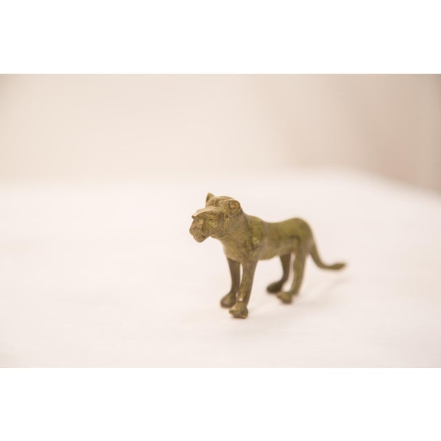 Vintage handmade bronze African sculpture of a lioness. Circa mid 20th century and possibly older, this piece has such...