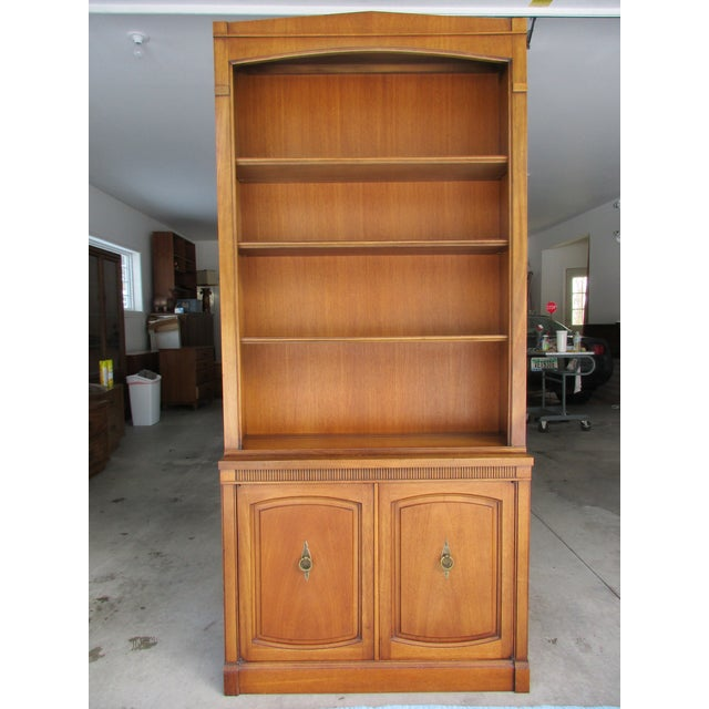 Here's a beautiful looking Drexel bookcase from their Triune line. The upper portion has three adjustable shelves with a...
