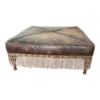 Distressed Brown Leather Large Ottoman With Fringe and Brass Nail Heads For Sale