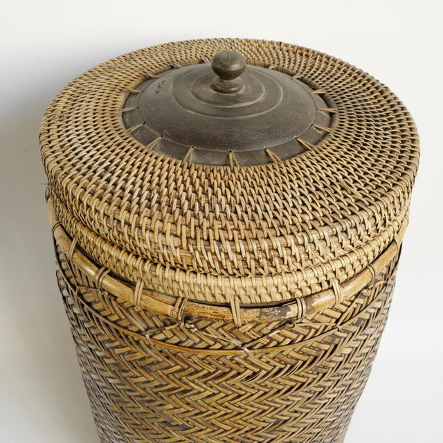 Vintage bamboo basket with wood handle lid. Beautiful hand made organic fiber. Great piece used for display or functional...