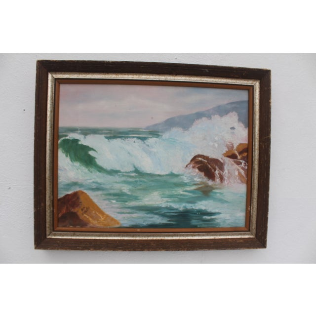Original French oil painting on canvas by Jean Papenfus. Depicts a coastal ocean scene with waves breaking over a rock...