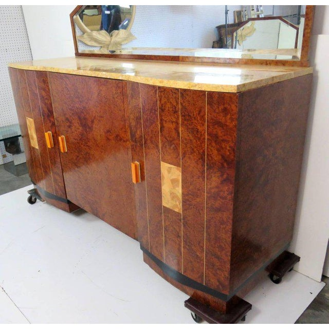 Marble top. Burl walnut with inlaid decorated doors. Mirror on top.