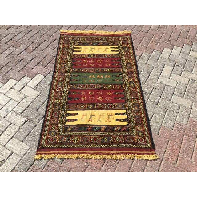 This beautiful, vintage, handwoven kilim is approximately 60 years old. It is handmade of very fine quality wool in all...