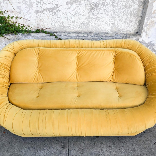 When life gives you lemons, turn them into a lemon yellow loveseat! This loveseat is vintage and has just been...