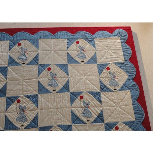 1930s Folky Mounted Red/White/Blue Sunbonnet Sue Crib Quilt with Balloon For Sale - Image 5 of 7