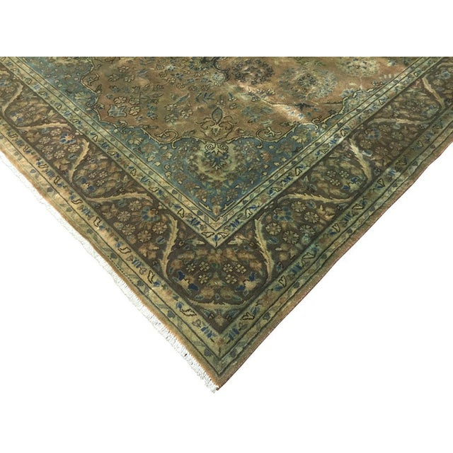 Beautiful tradition hand-knotted rug over dyed with a green hue is an elegant addition to any décor. Made with the finest...