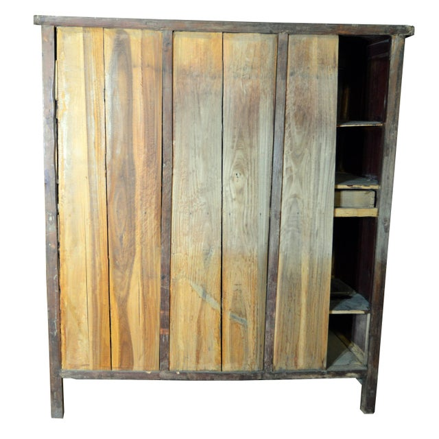 19th Century Chinese Qing Dynasty Wooden Armoire With Hand-Carved Gilt Panels For Sale - Image 9 of 13