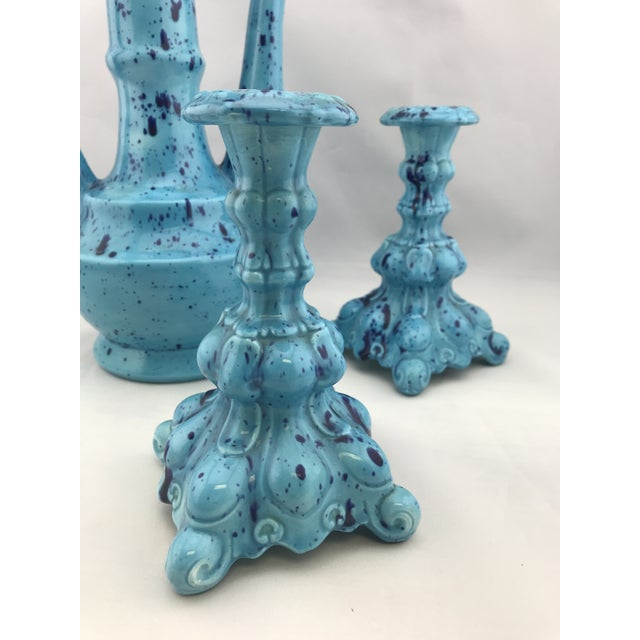Gorgeous turquoise and navy splatter ceramic 3 piece set. Tall decanter, w removeable stopper, and 2 candlesticks marked...