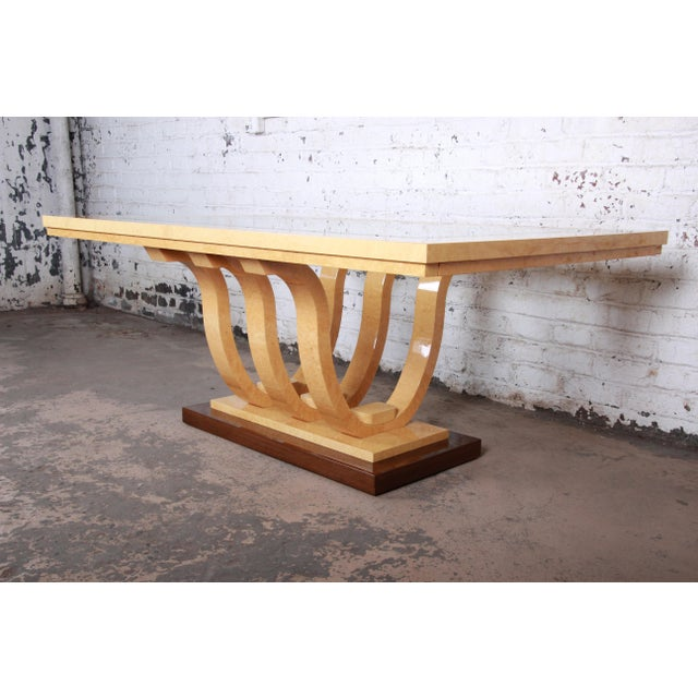 A gorgeous modern Italian Art Deco extension dining table. The table features stunning birdseye maple and mahogany wood...