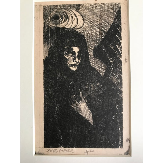 Vintage lithograph of an angel in black. Signed by James Angier and numbered 1/7. Matted and presented in a black frame....