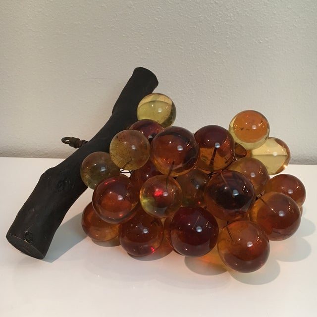 Offered is an extra large cluster of amber lucite grapes.