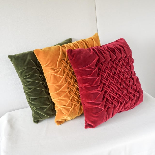 Beautiful set of richly colored vintage decorative throw pillows. These are made of velour in jewel shades of deep ruby...