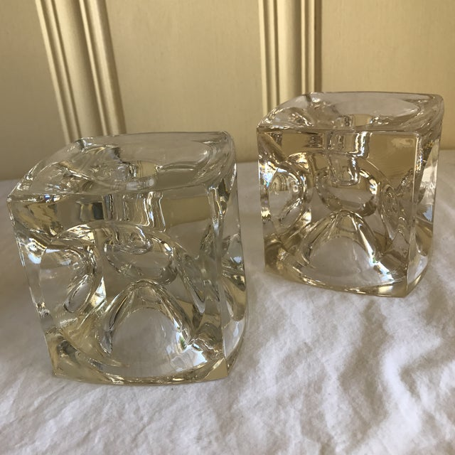 Modern vintage sculptural glass candleholders with geometric merging of round and square design. One is a slightly more...