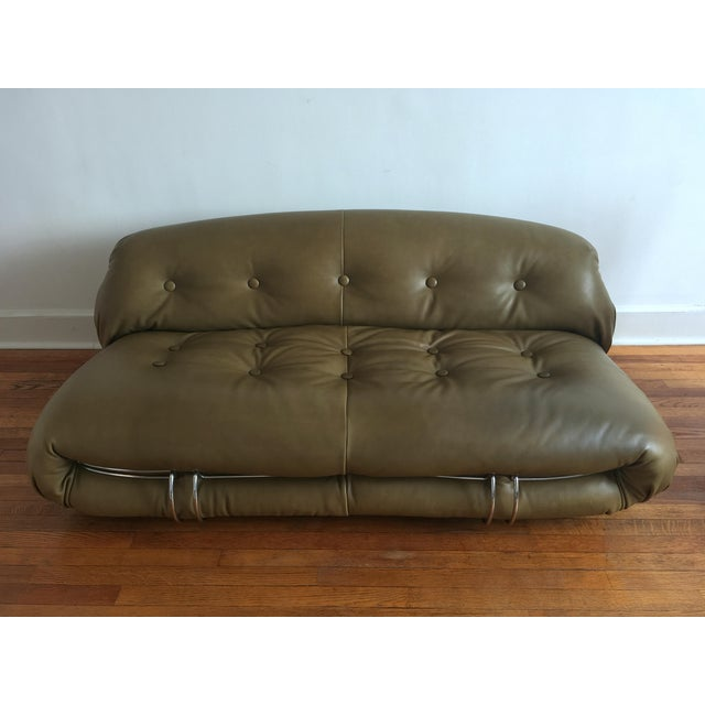 Dark olive green semi-aniline leather, 1970's, manufactured in Italy. External chrome-plated metal frame holds the...