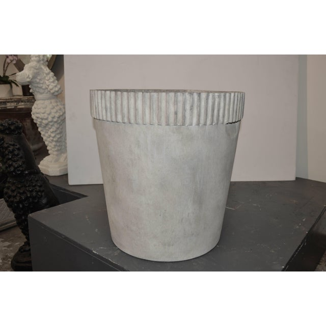 Cast fiber cement planter with ridges. It will take 3-4 weeks to make this piece
