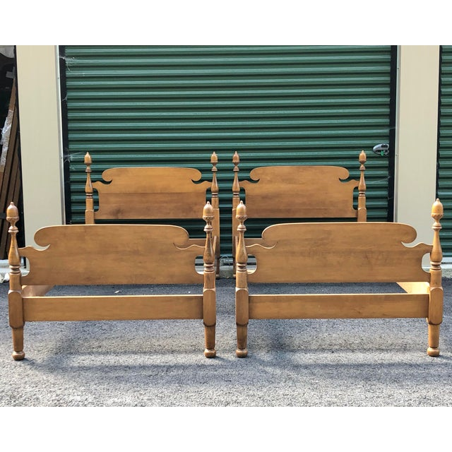 A pair of solid maple vintage acorn top post twin beds. This set includes two headboards, two footboards, side rails and...