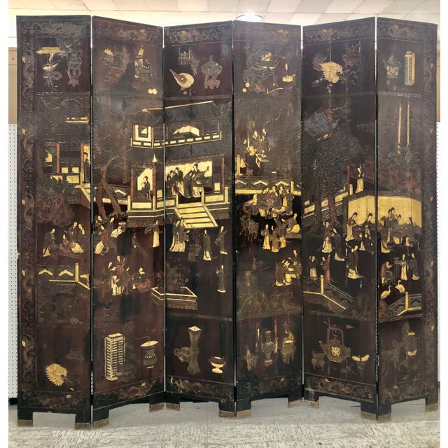 A six panel Chinese screen with figures, objects including teapots, vases, and animals. The screen is from the 1800's or...