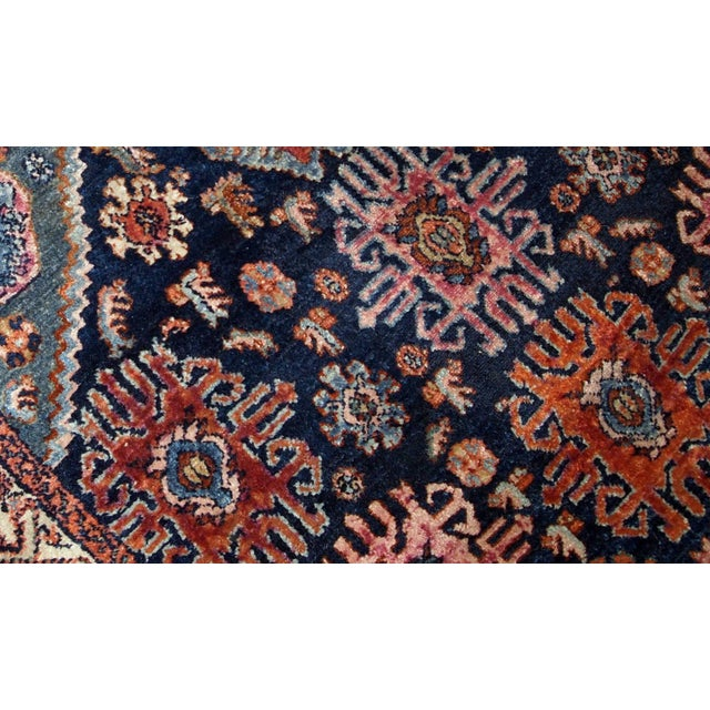 Handmade antique Malayer rug from the beginning of 20th century. The rug is in original good condition, has all-over...