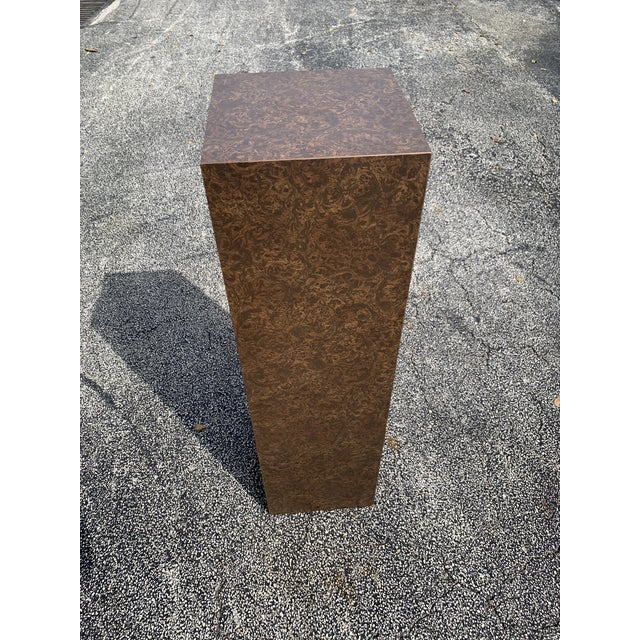 Milo Baughman inspired tall burl pedestal. Beautiful shades of deep and gold brown make this piece very elegant looking....
