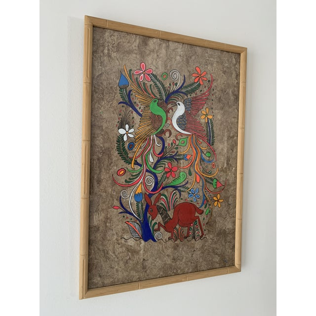 Framed Mexican folk art painting on Amate bark paper. Pair of colorful feathered birds tree hovering over cute red deer....