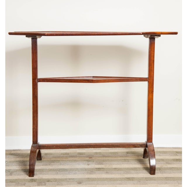 Directoire mahogany trestle table, early 19th century. An octagonal top with lower shelf table.
