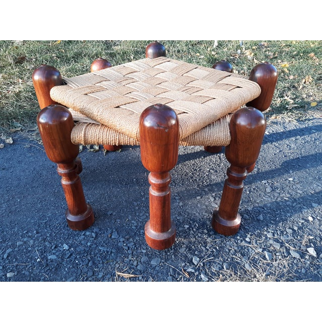 This is a pair of fine quality rosewood and rope stools or ottomans. They are unmarked but appear to be Scandinavian or...