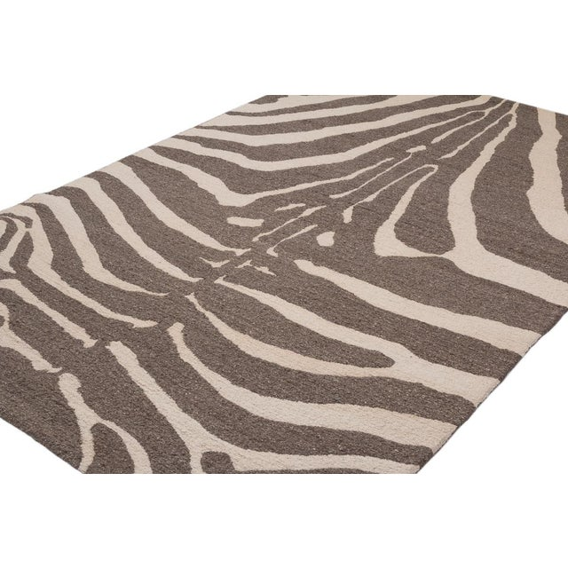 This contemporary zebra carpet design is an original by Joseph Carini. Handwoven using a brocade weave and natural...
