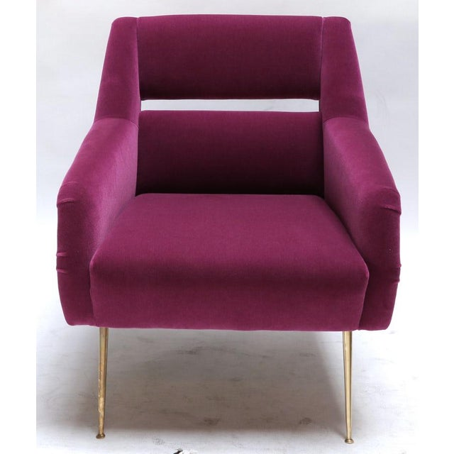 Custom 1960s Italian style armchairs with brass legs and upholstered in fuchsia mohair. Can be done in other fabrics and...