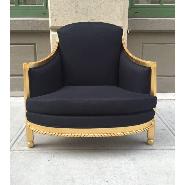 Italian, Black giltwood sculptural lounge chair manufactured by Colombostile Furniture Company. Gold leaf wooden frame and...