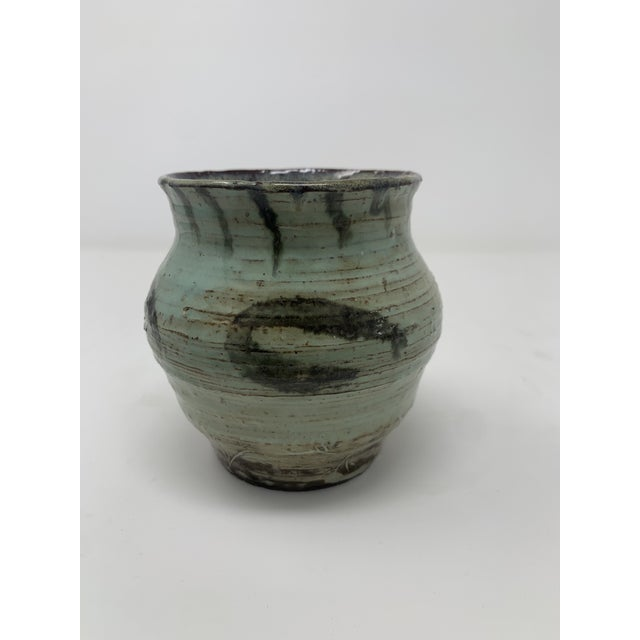 Beautiful mid-century small green vase with a contrasting brush stroke pattern. Signed.