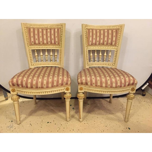 Pair of paint decorated Jansen style side chairs.