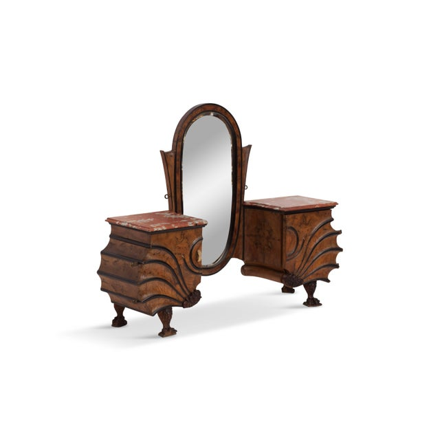 Extraordinary walnut and ebonized vanity table The eclectic piece shows a beautiful fan shaped form with details such as...