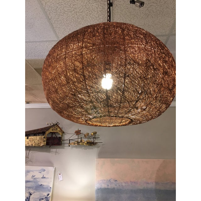 This stunning copper chandelier is made from woven copper wires. It is a great modern piece for over the dining table or...