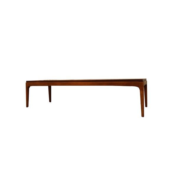 An American walnut rectangular coffee table. This Mid-Century Modern coffee table in walnut was made in Altavista, VA by...