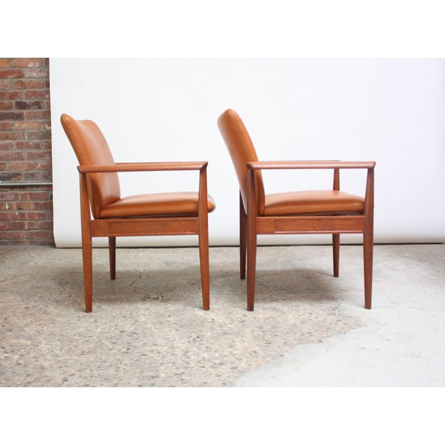 These teak 'Diplomat Chairs' were designed by Finn Juhl for France & Son circa 1961 and feature deeply sculpted arms and...