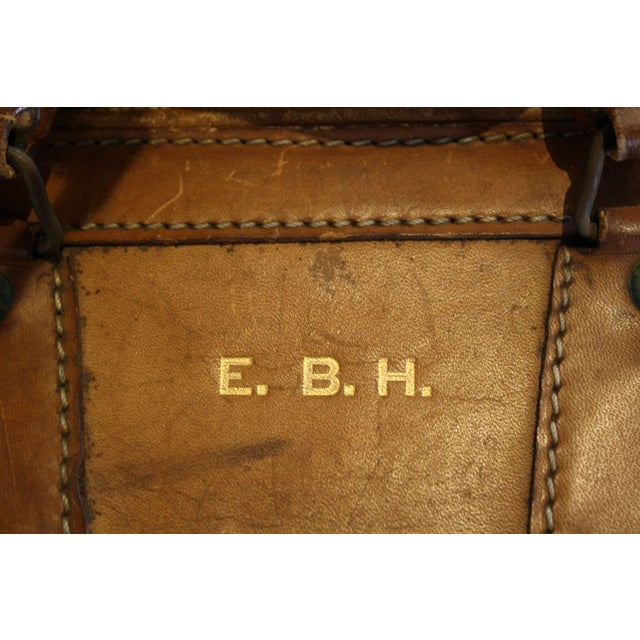 """A vintage leather luggage back with """"E.B.H."""" gold initials. We love a good monogram! A decorative piece that will lend a..."""