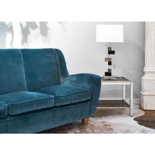 Italian vintage sofa by Poltrona Frau. Professionally reupholstered in a dark teal blue 100% cotton velvet, and custom...