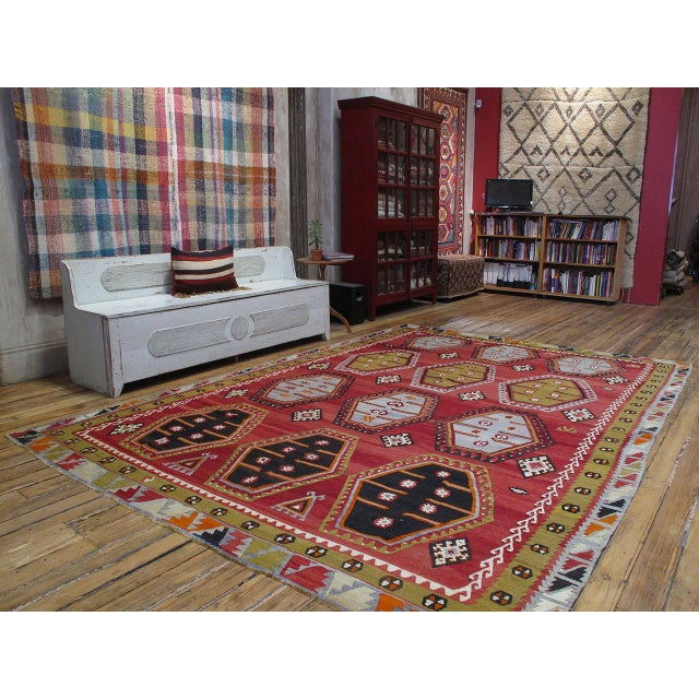An old Turkish Kilim in large format from the Sivas province in Eastern Turkey, featuring a well-known design of this...