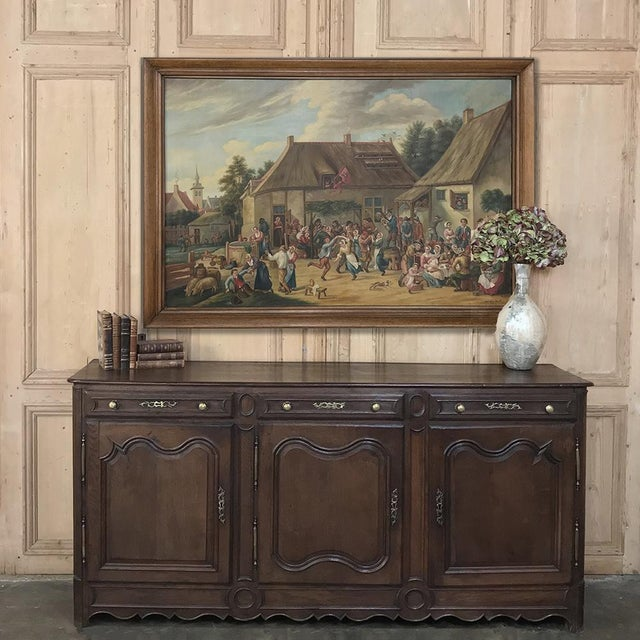 19th Century Country French Provincial Oak Low Buffet features tailored lines that are great for the casual look. Three...