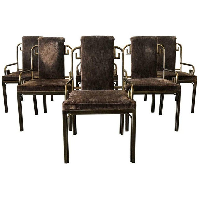 An absolutely stunning set of six Mastercraft brass Greek key dining chairs upholstered in a luxurious brown velvet with a...