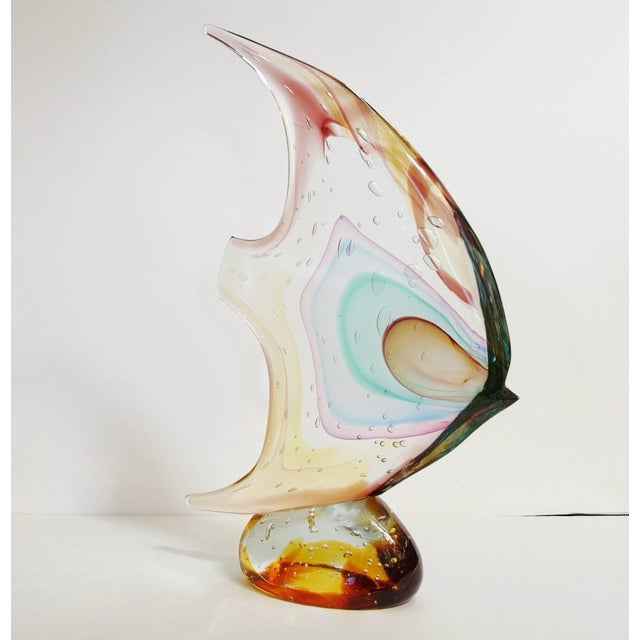 Italian fish on pebble sculpture hand blown and crafted in multiple colors of Murano glass by Sergio Constantini, signed...