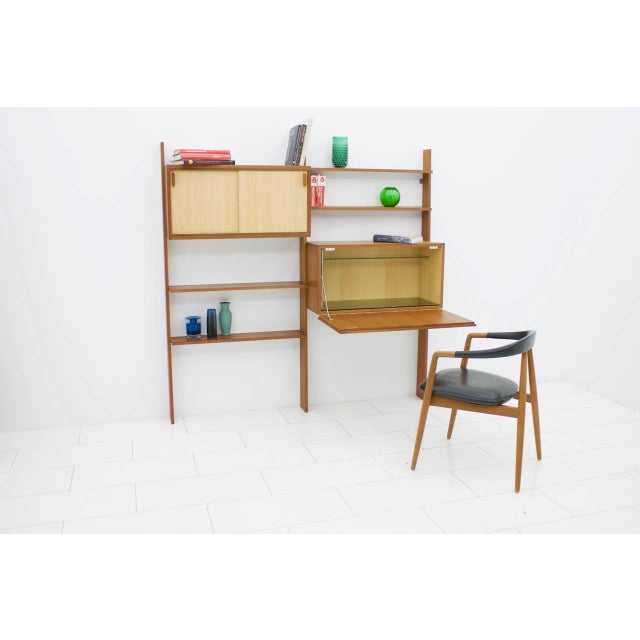 Rare teak shelf system by Dieter Waeckerlin with seagrass sliding doors. One cabinet with a bar or a desk and one cabinet...