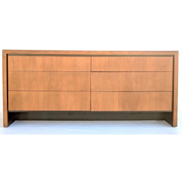 Mid-century six-drawer walnut lowboy dresser, designed by Merton Gershun for Esprit collection by Dillingham. This elegant...