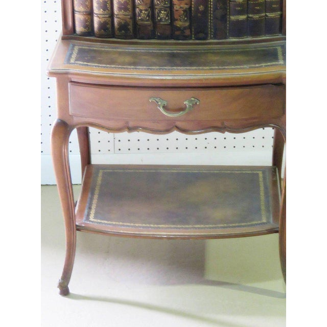 Louis XIV style leather trimmed marble-top step end table. Two doors over one drawer with a brass gallery.